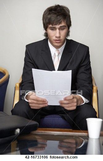 Worried businessman looking at papers